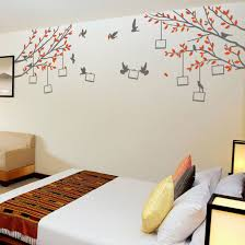 Beautiful Wall Stickers For Room Interior Design Bedroom Featuring Six Symmetrically Placed Decorations Above The