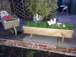 wooden pallet wheelbarrow planter 101 pallet ideas