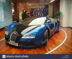 blue bugatti blue bugatti veyron on display in berlin dealer u0027s showroom stock