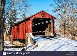 pool forge covered bridge with christmas decorations in the amish