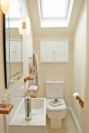white toilet bowl and white sink on cermaics flooring added by