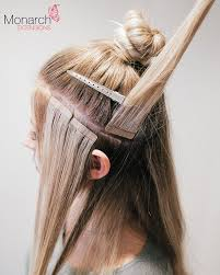 Hair Extension Tips by How To Place Tape Hair Extensions When Creating A Top Knot Bun Or