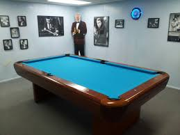 brunswick brighton pool table brunswick gibson pool table in a room of pool player posters