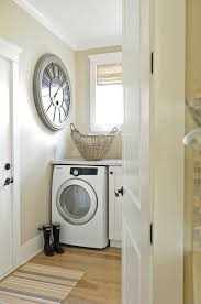 washer and dryer under marble countertop transitional laundry room