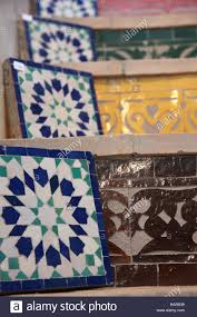 zellij mosaic tiles displayed for sale on tiled stairs in u0027art