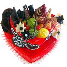 How To Decorate Heart Shaped Cake Red Glaze Heart Shape Cake Topped With Fruits And Chocolate Decoration