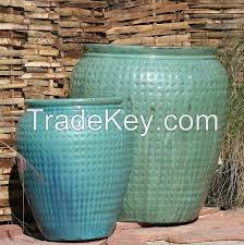 tall round barrels large glazed ceramic planters light blue pots