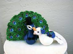 peacock wedding cake topper this adorable peacock and peahen is made to order they are