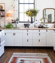 cheap kitchen cabinet pulls a rental kitchen spiffed up with leather cabinet pulls kitchn
