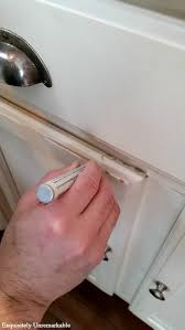 how to touch up white gloss kitchen cabinets how to touch up chipped cabinets with a paint pen