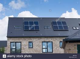 solar panels on houses domestic solar panels on the rooftop of newly built houses stock