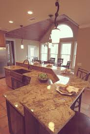 image result for kitchen island with sink and dishwasher and bar i love this island bar i want this for my basement sophisticated white mosaic granite top bar kitchen island with seating and single sink in open plan