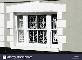 looking at sash windows with ornamental security bars inside