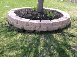 Done Right Landscaping by A Retaining Wall For Tree Jumbo Cobblestone Border Around