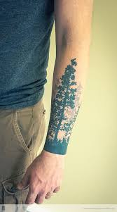 pine tree on forearm wth