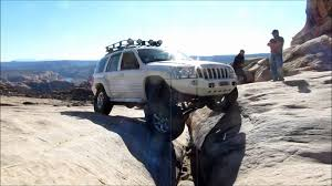 rose gold jeep cherokee wj grand cherokee crossing golden on golden spike in moab
