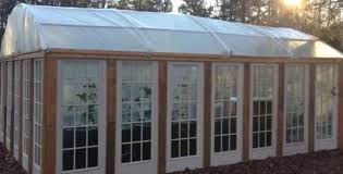 Greenhouse Windows by Diy Hoop House Built With Recycled Doors Greenhouse For Cheap