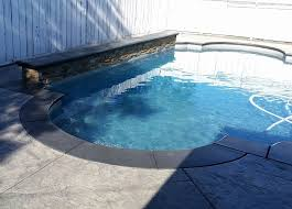 grey stamped concrete pool deck with broomed finish band yelp