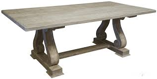 old and vintage trestle dining table made from reclaimed wood with