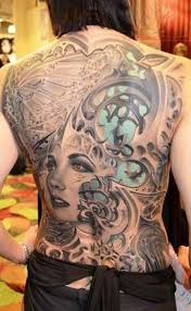 biomechanical tattoo face biomechanical and girl face tattoo on back