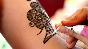 applying henna tattoo on a south indian bride tamil nadu stock
