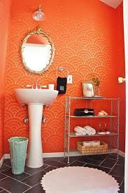 beautiful orange wall paint in modern bathroom vanity with white