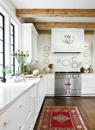 love the stove dark wood floors lighter wood beams white cream