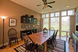 country dining room with ceiling fan u0026 carpet in grand rapids mi