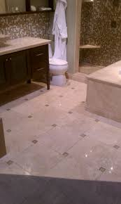 travertine tile with green glass tile in pinwheel configuration