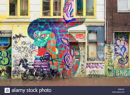 amsterdam painted dragon wall murals on a squat bar called the amsterdam painted dragon wall murals on a squat bar called the vrankrijk in spui straat street parked bicycles