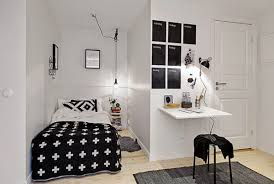 small bedroom with grey walls and using white table lamps