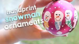 handprint snowman ornaments diy christmas decorations on a