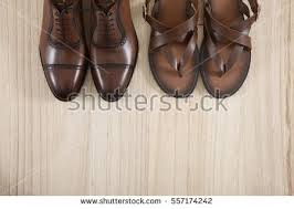 brown leather shoes sitting on wood stock photo 390432151