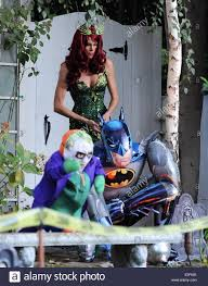 brooke burns dressed as poison ivy for halloween night at her home