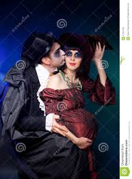 halloween couple wearing vampire and witch royalty free stock