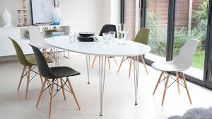 Extended Dining Table by White Extending Dining Table And Eames Style Dining Chairs Youtube