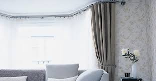 image of interior bay window curtain rod
