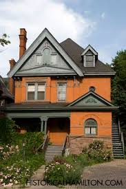 orange brick house beige gray accents and what other colors for