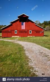 red barn with american flag near franklin tennessee usa stock
