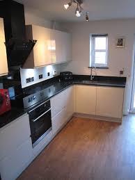black granite worktop grey and black tiles u0026 white gloss units