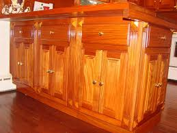 cool orange color mahogany wood kitchen cabinets with double door