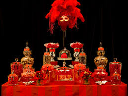 dramatic and theatrical red and gold candy buffet candy bars