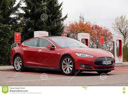 tesla model s charging red tesla model s electric car charging editorial stock photo