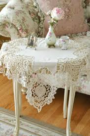 small shabby chic end table with lace tablecloth and accessories