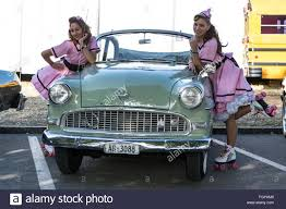 opel car 1950 pin up girls posing with old opel stock photo royalty free image