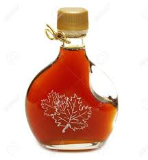 ribbon syrup a small bottle of maple syrup with the maple leaves printed on