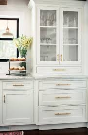 what hardware for shaker cabinets glass front china cabinet with brass pulls transitional