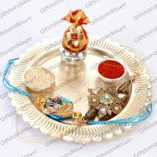 send german silver surya thali with beautiful rakhis to india