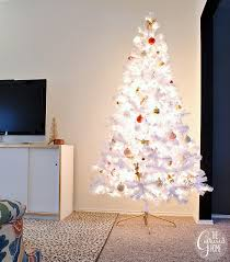 white tree with and gold decorations happy holidays