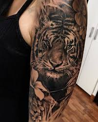 black and grey tiger on the left arm and shoulder
